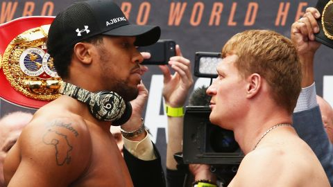 Anthony Joshua (left) has an outline of Africa on his right shoulder.