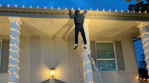 A dummy of Clark Griswold hangs from the roof. Heerlein spent two days assembling Griswold's outfit.