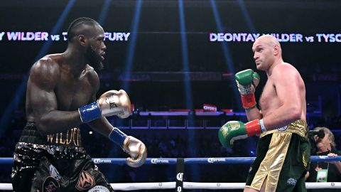 Joshua had been expected to fight either Deontay Wilder (left) or Tyson Fury (right) next.