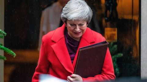 LONDON, ENGLAND - DECEMBER 03:  British Prime Minister Theresa May leaves Downing Street in the rain to address the House of Commons since her return from the G20 summit on December 3, 2018 in London, England. Members of Parliament will vote on the Brexit deal Ms May has reach with the European Union on December 11.   (Photo by Dan Kitwood/Getty Images)