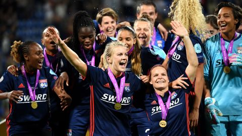 Hegerberg (C) and her teammates celebrate winning the UEFA Women's Champions League in May, 2018.