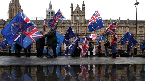 Pro-European Union (EU), anti-Brexit demonstrators wave Union and EU flags as they protest opposite the Houses of Parliament in London on December 3, 2018. - Britain's Prime Minister Theresa May said last week it was up to MPs to decide whether Britain leaves the European Union next March with no deal despite the potentially catastrophic impact. (Photo by Daniel LEAL-OLIVAS / AFP)        (Photo credit should read DANIEL LEAL-OLIVAS/AFP/Getty Images)
