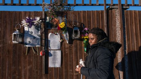 Tilisha Goupall tends a memorial for her younger brother, Jermaine Goupall, at the spot where he was killed by gang members in south London.
