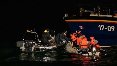 Iranian migrants travelling in a dinghy across the Channel are picked up by the RNLI and French Maritime Police.