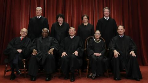 WASHINGTON, DC - NOVEMBER 30: United States Supreme Court Justices pose for their official portrait at the in the East Conference Room at the Supreme Court.