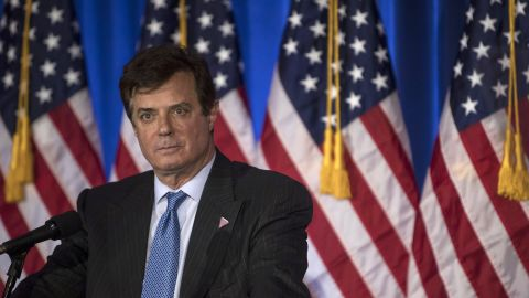 FILE: Paul Manafort, a Trump campaign worker, stands on stage before Donald Trump, presumptive Republican presidential candidate, speaks during a primary night event at the Trump National Golf Club Westchester in Briarcliff Manor, New York, U.S., on Tuesday, June 7, 2016. Manafort, a former campaign manager for President Donald Trump, and his onetime business partner Rick Gates were charged with conspiracy against the U.S., the first people charged in the broad investigation into Russian meddling with the U.S. election. Photographer: Victor Blue/Bloomberg via Getty Images