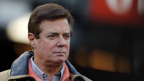 NEW YORK, NEW YORK - OCTOBER 17: Former Donald Trump presidential campaign manager Paul Manafort looks on during Game Four of the American League Championship Series at Yankee Stadium on October 17, 2017 in the Bronx borough of New York City. (Photo by Elsa/Getty Images)