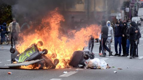 A fire blazes on the Pont Neuf, in Toulouse in December 2018 in a gilets jaunes protest.