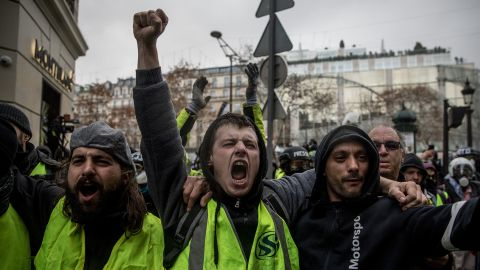 PARIS, FRANCE - DECEMBER 08: Protesters chant slogans as during the 'yellow vests' demonstration on the Champs-Elysées near the Arc de Triomphe on December 8, 2018 in Paris France. ''Yellow Vests' ('Gilet Jaunes' or 'Vestes Jaunes') is a protest movement without political affiliation which was inspired by opposition to a new fuel tax. After a month of protests, which have wrecked parts of Paris and other French cities, there are fears the movement has been infiltrated by 'ultra-violent' protesters. Today's protest has involved at least 5,000 demonstrators gathering in the Parisian city centre with police having made over 200 arrests so far.  (Photo by Chris McGrath/Getty Images)