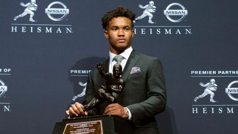 Oklahoma quarterback Kyler Murray poses with the Heisman Trophy on Saturday  in New York.