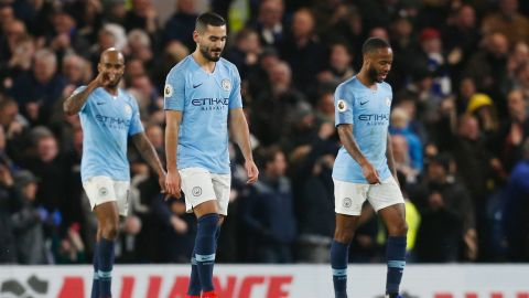 Manchester City midfielders Fabian Delph, Ilkay Gundogan and Raheem Sterling react after Chelsea scores its second goal.