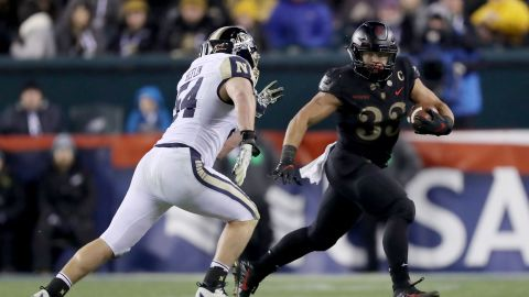 Darnell Woolfolk of the Army Black Knights carries the ball as Navy's Taylor Heflin defends at Lincoln Financial Field in Philadelphia.