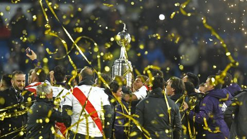 River Plate celebrates with the trophy after winning the second leg of the all-Argentine Copa Libertadores final.