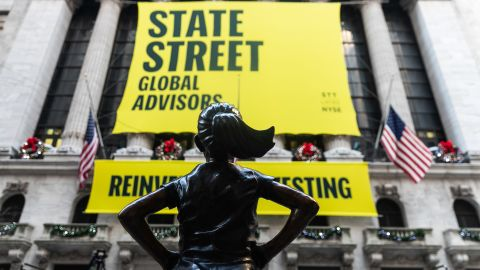 """The """"Fearless Girl"""" statue stands outside New York Stock Exchange (NYSE) in New York, U.S., on Monday, Dec. 10, 2018. The hands-on-hips bronze statue that inspired millions with a message of female empowerment has a new permanent home in front of the NYSE. """"Fearless Girl"""" was intended as a temporary display when the Boston-based State Street Global Advisors installed it in March 2017 to encourage corporations to put more women on their boards. Photographer: Jeenah Moon/Bloomberg via Getty Images"""