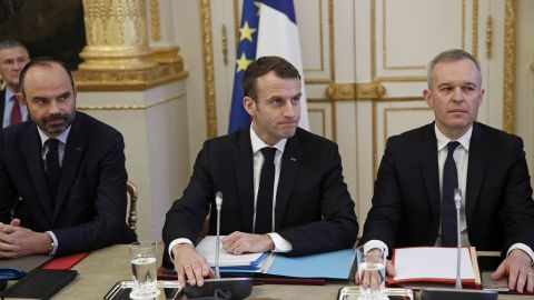 Prime Minister Edouard Philippe, President Emmanuel Macron and Ecology Minister François de Rugy meet with trade union leaders on Monday.