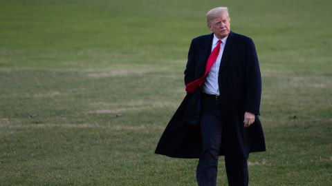 US President Donald Trump walks from Marine One after arriving on the South Lawn of the White House in Washington, DC, December 7, 2018, following a day trip to Kansas City, Missouri. (SAUL LOEB/AFP/Getty Images)