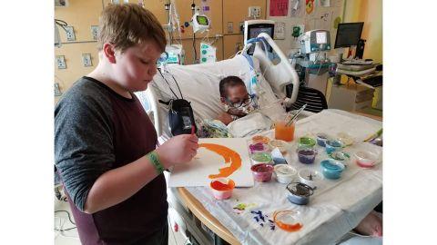 Kaleb Klakulak, 12, paints with K.J. in the hospital.