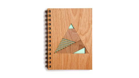"""<strong>Geometric Pyramid Laser Cut Wood Journal ($29; </strong><a href=""""https://amzn.to/2L7y5eI"""" target=""""_blank"""" target=""""_blank""""><strong>amazon.com</strong></a><strong>) </strong>"""