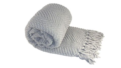 """<strong>Home Soft Things Boon Knitted Tweed Throw Couch Cover Blanket ($32.67; </strong><a href=""""https://amzn.to/2Ef5gLY"""" target=""""_blank"""" target=""""_blank""""><strong>amazon.com</strong></a><strong>)</strong>"""