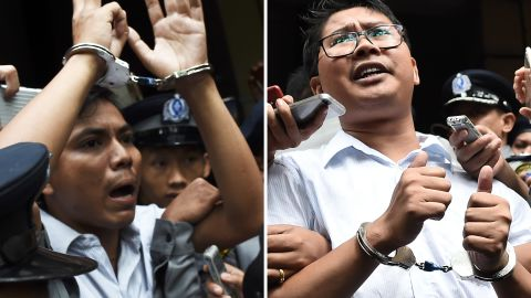 Journalists Kyaw Soe Oo, left, and Wa Lone, right, being escorted by police after their sentencing by a court to jail in Yangon on September 3, 2018.