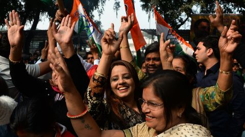 Indian Congress party supporters celebrate outside the party headquarters in New Delhi on December 11, 2018.