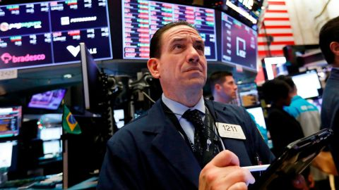 FILE- In this Dec. 6, 2018, file photo trader Tommy Kalikas works on the floor of the New York Stock Exchange. The U.S. stock market opens at 9:30 a.m. EST on Tuesday, Dec. 11. (AP Photo/Richard Drew, File)