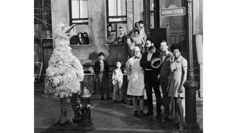 """Circa 1969: Cast members of the television show """"Sesame Street"""" on the set with some of the puppet characters."""
