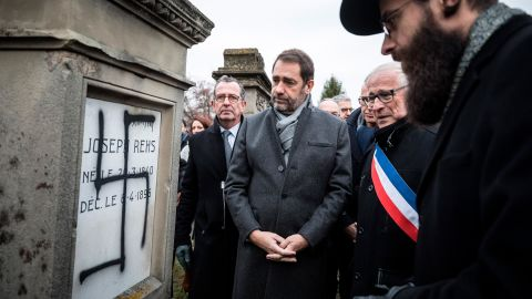 French Interior Minister Christophe Castaner, center, attends a ceremony at the Jewish cemetery of Herrlisheim with Strasbourg Rabbi Harold Weill, right, and Herrlisheim Mayor Louis Becker, second from right.