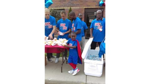 Austin Perine travels to Detroit to feed the homeless in his superhero red cape.