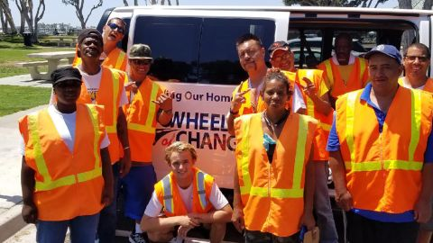 """San Diego teen Kevin Barber (center) poses with his """"Wheels of Change"""" crew."""