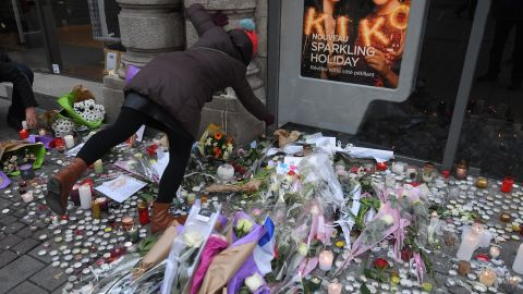 People light candles Friday in a tribute to the Christmas market attack victims in Strasbourg, France.