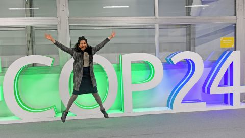 A participant jumps for a picture at the COP24 climate talks in Katowice, Poland, on December 14.