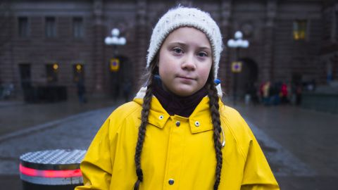 """Swedish 15-year-old girl Greta Thunberg holds a placard reading """"School strike for the climate"""" during a protest against climate change outside the Swedish parliament on November 30, 2018. - In more than hundred cities across Sweden, environmentalists have organised protests, partly inspired by Greta Thunberg, who strikes every Friday against climate change outside the parliament since several months. UN's annual climate talks which this year will take place in Poland starts on December 2, 2018. (Photo by Hanna FRANZEN / TT News Agency / AFP) / Sweden OUT        (Photo credit should read HANNA FRANZEN/AFP/Getty Images)"""