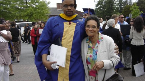 Jermaine McBean stands with his grandmother at his graduation in June 2007 at New York's Pace University.