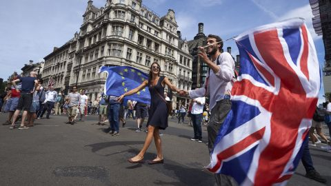 Demonstrators wave the Union Flag as they participate in the People's March demanding a People's Vote on the final Brexit deal, in central London on June 23, 2018, the second anniversary of the 2016 referendum. - Tens of thousands of people demonstrated in London on Saturday calling for a second vote on Britain's departure from the European Union. (Photo by Niklas HALLE'N / AFP)        (Photo credit should read NIKLAS HALLE'N/AFP/Getty Images)