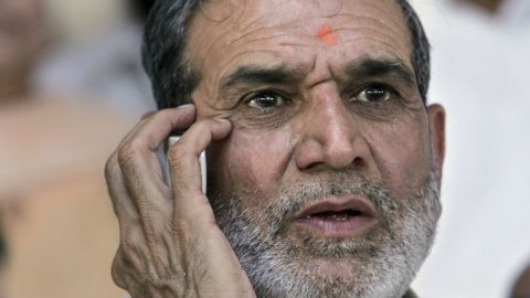 In this August 2005 file photo, Sajjan Kumar talks on a mobile phone at an event in New Delhi. An Indian court has sentenced Kumar for his role in inciting violence during anti-Sikh pogroms in 1984.