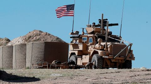 FIEL - In this April 4, 2018, file photo, a U.S. soldier sits on an armored vehicle on a newly installed position, near front line between the U.S-backed Syrian Manbij Military Council and the Turkish-backed fighters, in Manbij, north Syria. The drama of U.S. and allied missiles strikes on Syria has obscured the fact that the U.S.-led campaign to eliminate the Islamic State from Syria has stalled. This is an illustration of the many-layered complexities of the Syrian conflict.  (AP Photo/Hussein Malla, File)