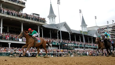 Jockey John Valazquez, riding Animal Kingdom #16, leads the field across the finish line to win the 137th Kentucky Derby at Churchill Downs on May 7, 2011 in Louisville, Kentucky.