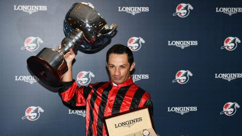 HONG KONG, HONG KONG - DECEMBER 05: Silvestre De Sousa representing Great Britain poses with the trophy after winning championship during the LONGINES International Jockeys' Championship at Happy Valley Racecourse on December 05, 2018 in Hong Kong. (Photo by Vince Caligiuri/Getty Images)