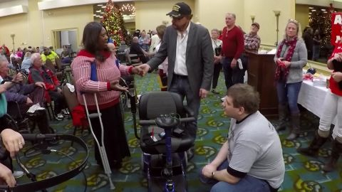 Robbie Drummer thanks Phil Pavone, the man who started the annual giveaway event, for her refurbished wheelchair.