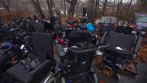 Donated wheelchairs stacked up behind Pavone's pawn shop will be utilized for parts.