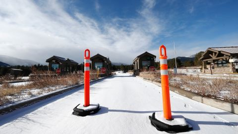 A lane is blocked to an unattended toll booth at Rocky Mountain National Park Saturday, December 22, in Estes Park, Colo. A partial federal shutdown has been put in motion because of gridlock in Congress over funding for President Donald Trump's  Mexican border wall. The gridlock blocks money for nine of 15 Cabinet-level departments and dozens of agencies including the departments of Homeland Security, Transportation, Interior, Agriculture, State and Justice.