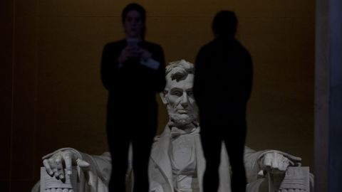 Two people stand in front of the Lincoln Memorial on Saturday, December 22. Many of the National Mall sights remained open despite the shutdown.