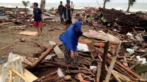 """Residents inspect the damage to their homes on Carita beach on December 23, 2018, after the area was hit by a tsunami on December 22 that may have been caused by the Anak Krakatoa volcano. - At least 43 people have been killed and nearly 600 injured in a tsunami in Indonesia that may have been caused by a volcano known as the """"child"""" of the legendary Krakatoa, officials said on December 23. Hundreds of buildings were destroyed by the wave, which hit beaches without warning in South Sumatra and the western tip of Java about 9.30 pm local time (1430 GMT) on December 22, national disaster agency spokesman Sutopo Purwo Nugroho said in a statement. (Photo by Semi / AFP)        (Photo credit should read SEMI/AFP/Getty Images)"""