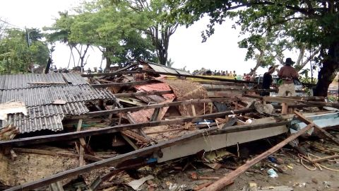 Residents inspect the damage to their homes on Carita beach on December 23.