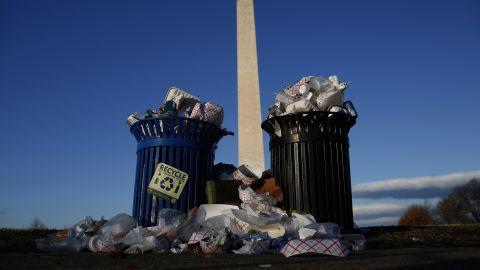 A public trash can spills over on Washington's Pennsylvania Avenue on Monday, December 24.