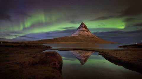 <strong>Kirkjufell, Iceland: </strong>The aurora borealis, or northern lights, are seen over Kirkjufell, a 463-meter mountain on the west coast of Iceland.