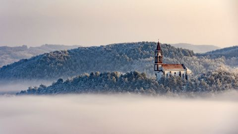 <strong>Soshartyan, Hungary:</strong> As December temperatures fall below 0 Celsius (32 F), a church stands above a layer of fog in the Hungarian village of Soshartyan. <br />