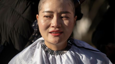 Li Wenzu has her head shaved to protest the detention of her husband and Chinese human rights lawyer Wang Quanzhang on December 17.