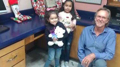 Randy Heiss poses for a photo with Dayami and her 4-year-old sister.